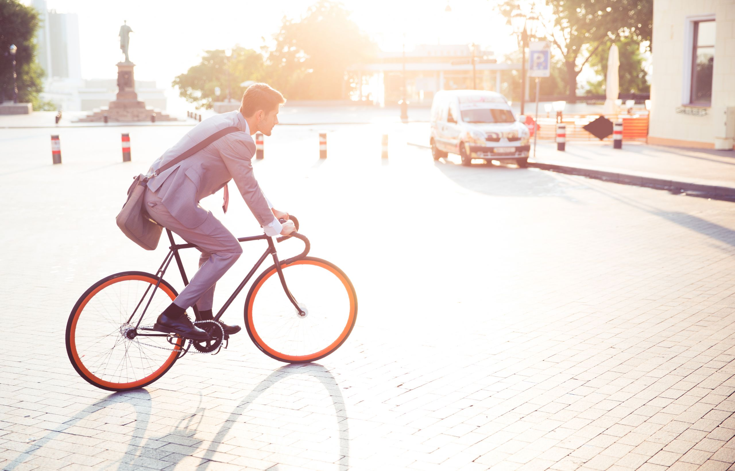 A businessman riding bicycle to work